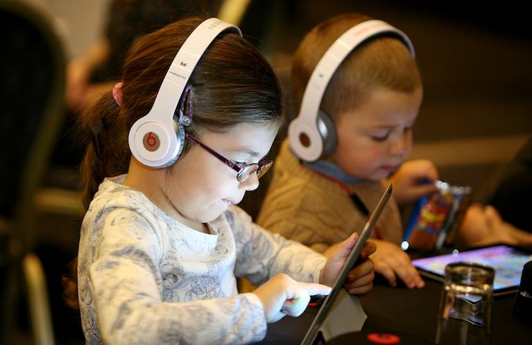 Children watching their iPad