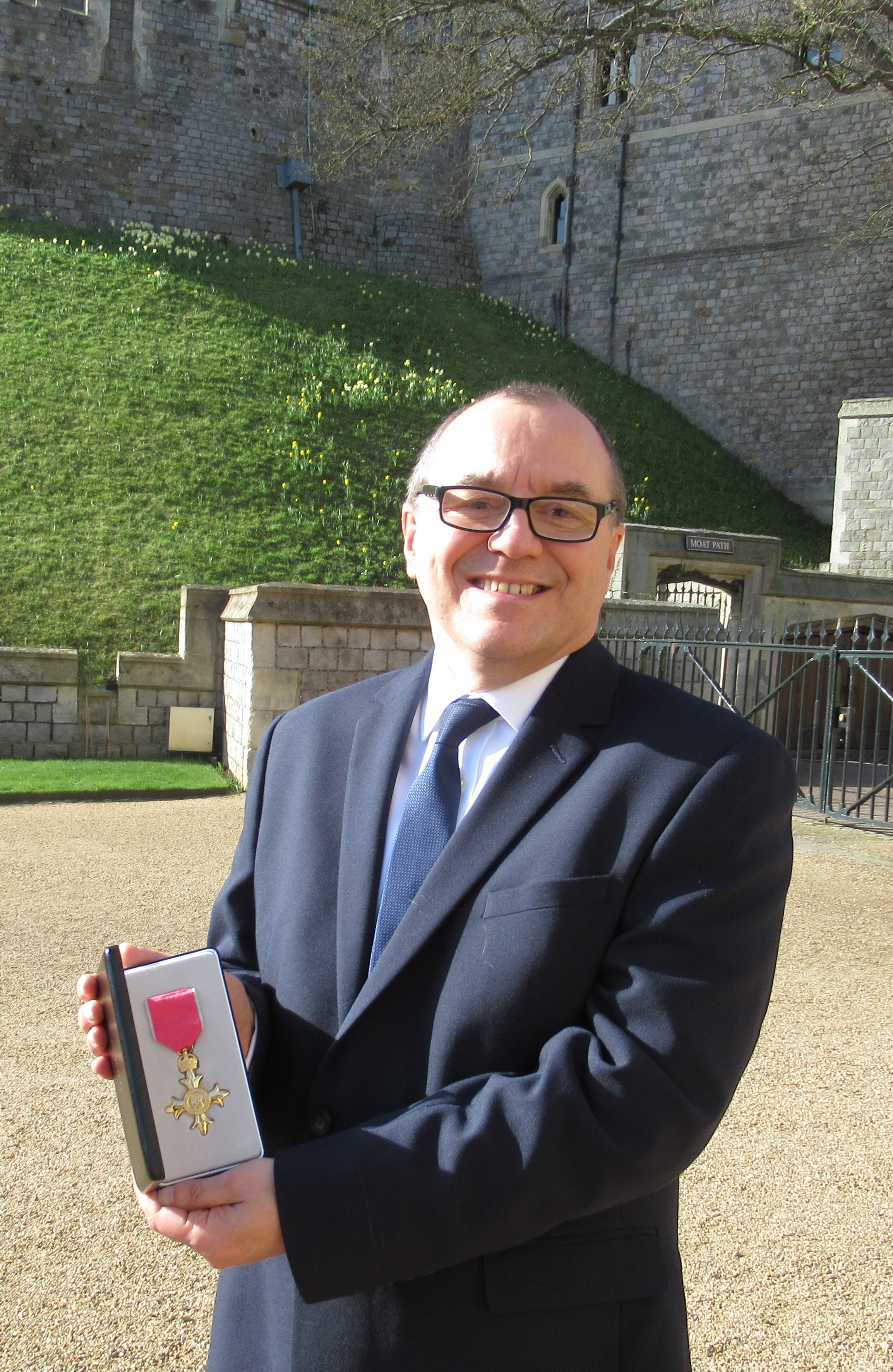 Richard receives his OBE from Her Majesty the Queen