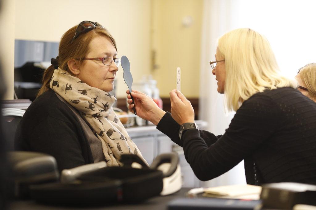 A woman undergoing a sight test.