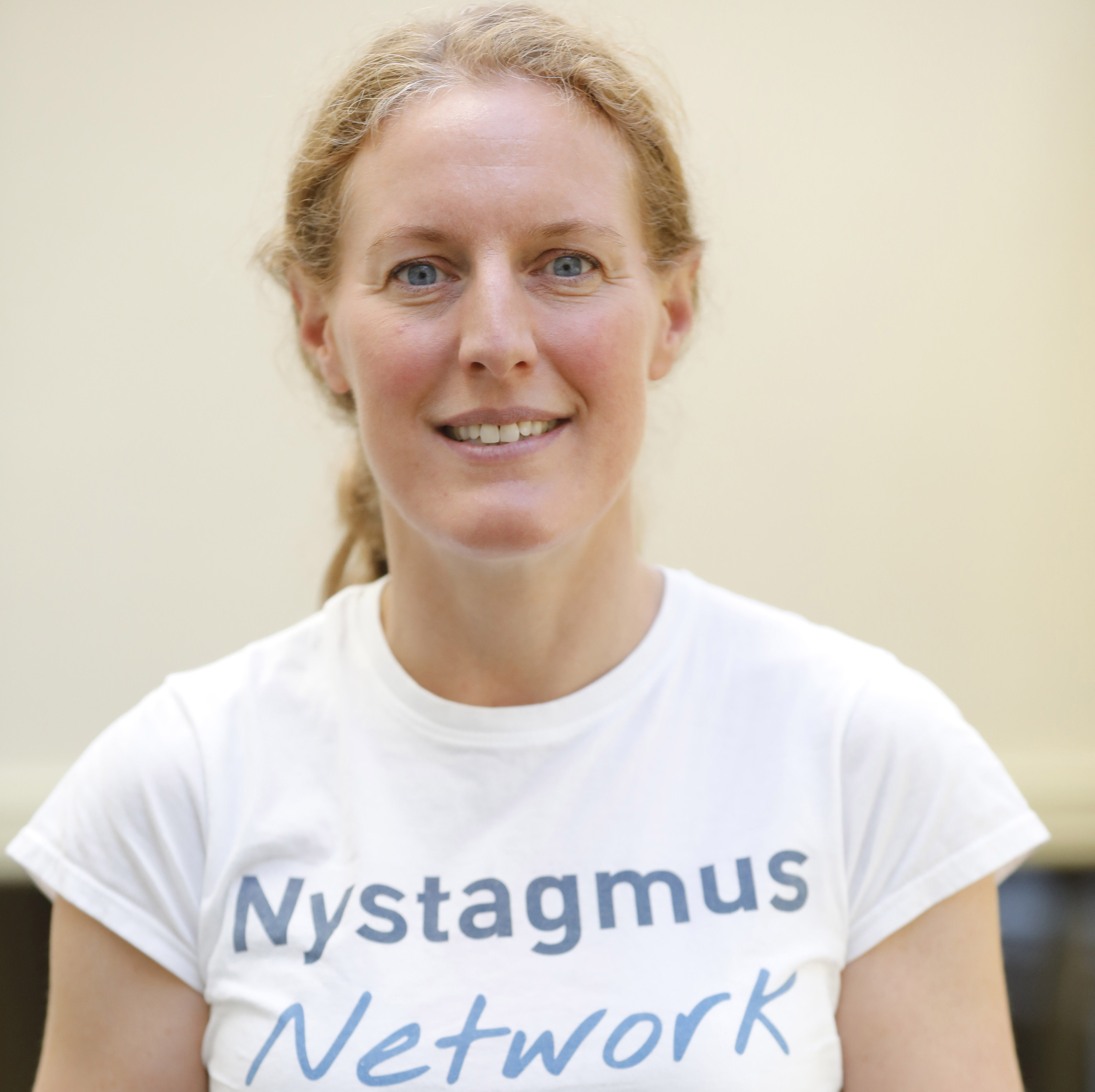 Claire Brinn wearing her Nystagmus Network T shirt