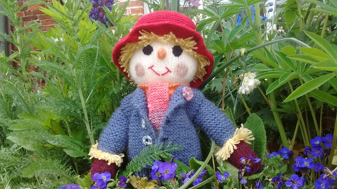 Trumpet the knitted scarecrow.