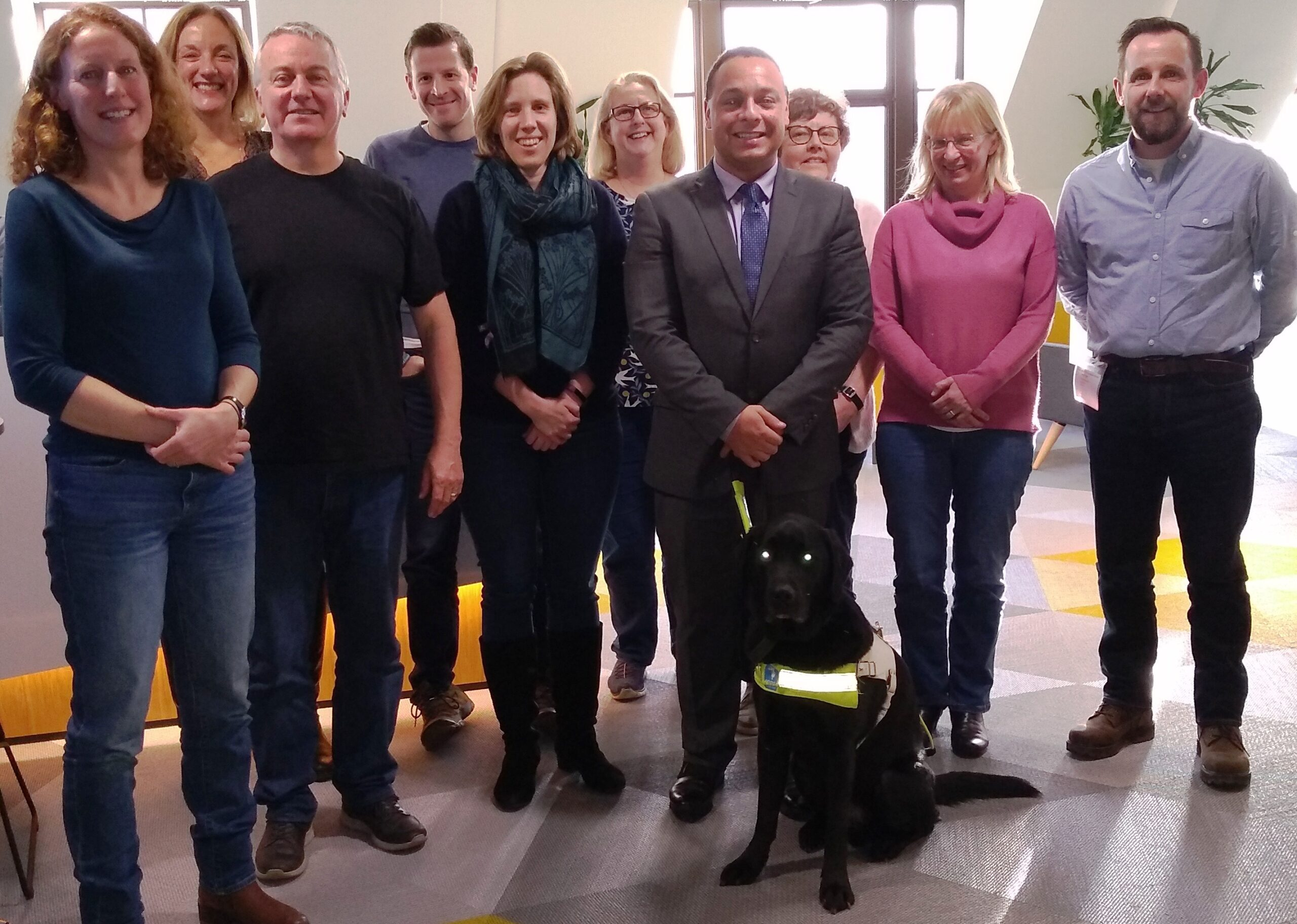 Nystagmus Network trustees stand together and smile at the camera.