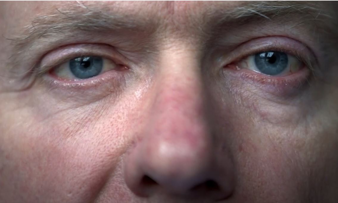 A close up of a man's eyes.