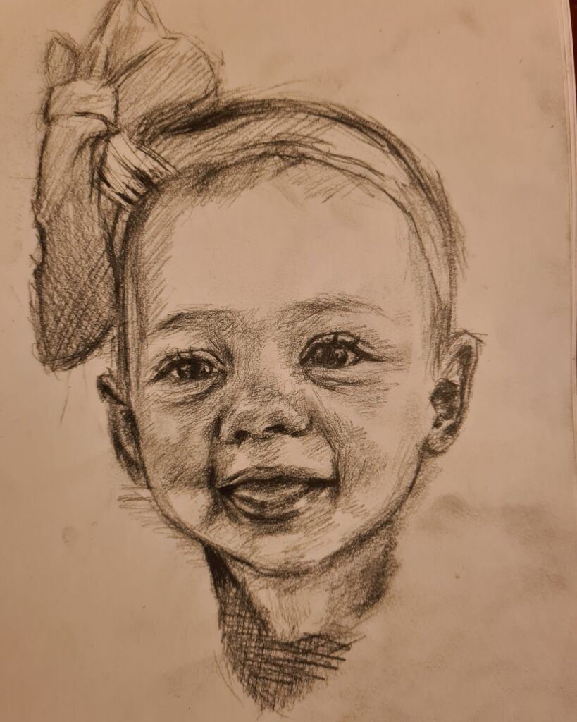 Rubyrae's drawing of a young child.