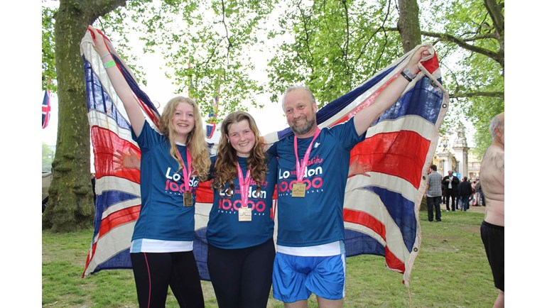 3 runners celebrate completing their run