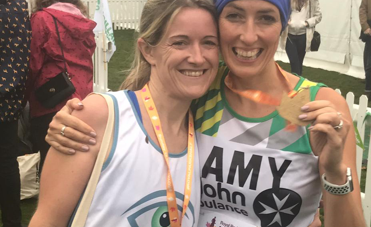 Runners in Nystagmus Network vests with medals.