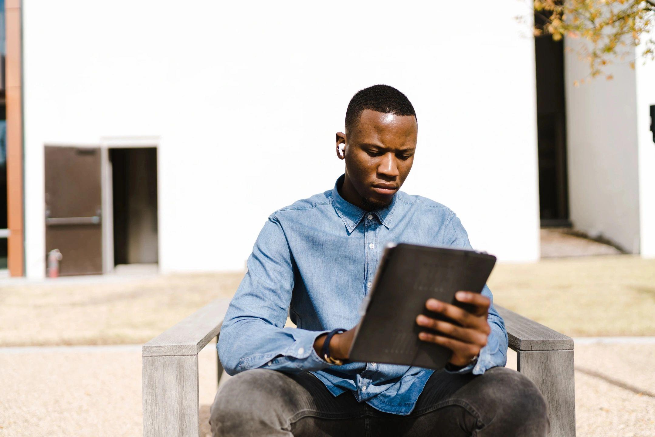 A man studies a laptop.