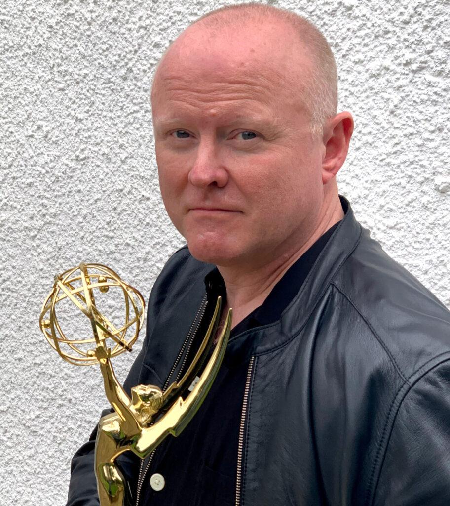 Tim holding an award